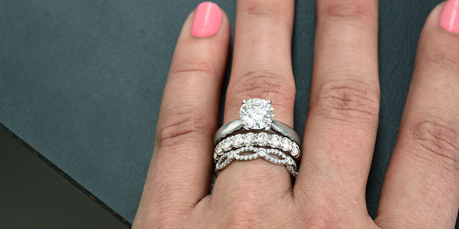 stacked engagement ring with wedding band and anniversary ring